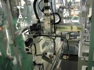 防湿剤塗布・充填装置